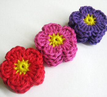Handmade crocheted cotton flower appliques set of twelve purple pink red