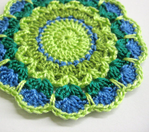 Crocheted flower motif, mini doilie in blue and green shades,  3,5 inches w