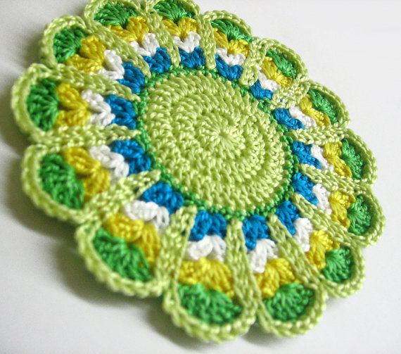Crocheted motif, mandala applique in  light green, yellow, turquoise, white