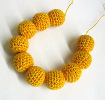 Crocheted beads 20 mm handmade dark yellow cotton on wood, 10pc. (B20042)
