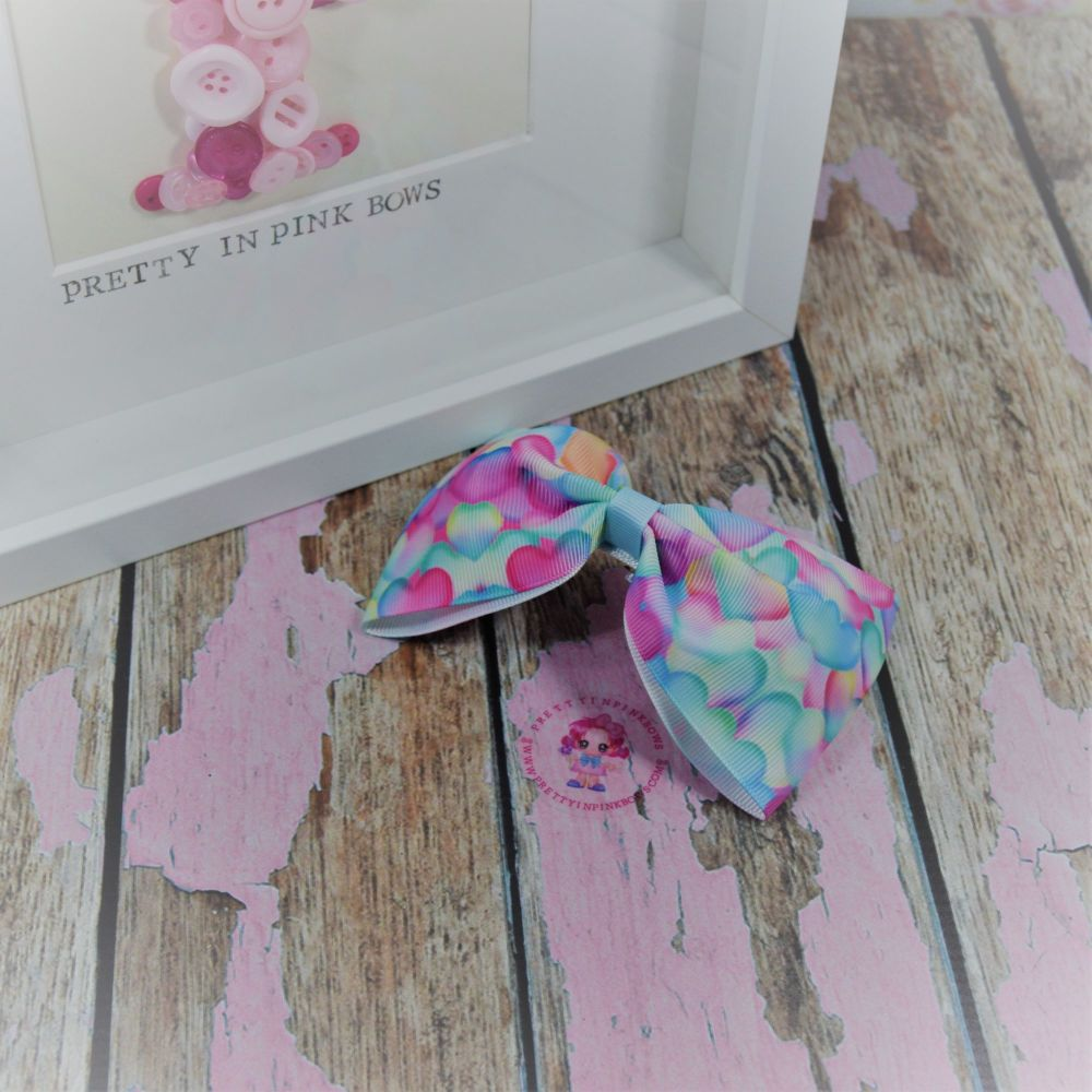 Large Minnie bow ~ Water colour hearts - on croc
