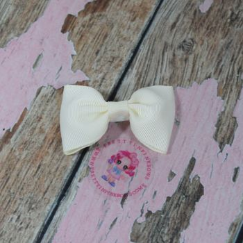 Minnie Bow On Croc Clip ~ Cream