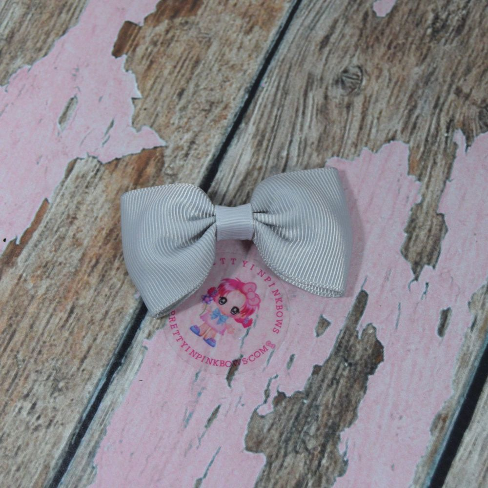 Minnie Bow On Croc Clip ~ Light Silver