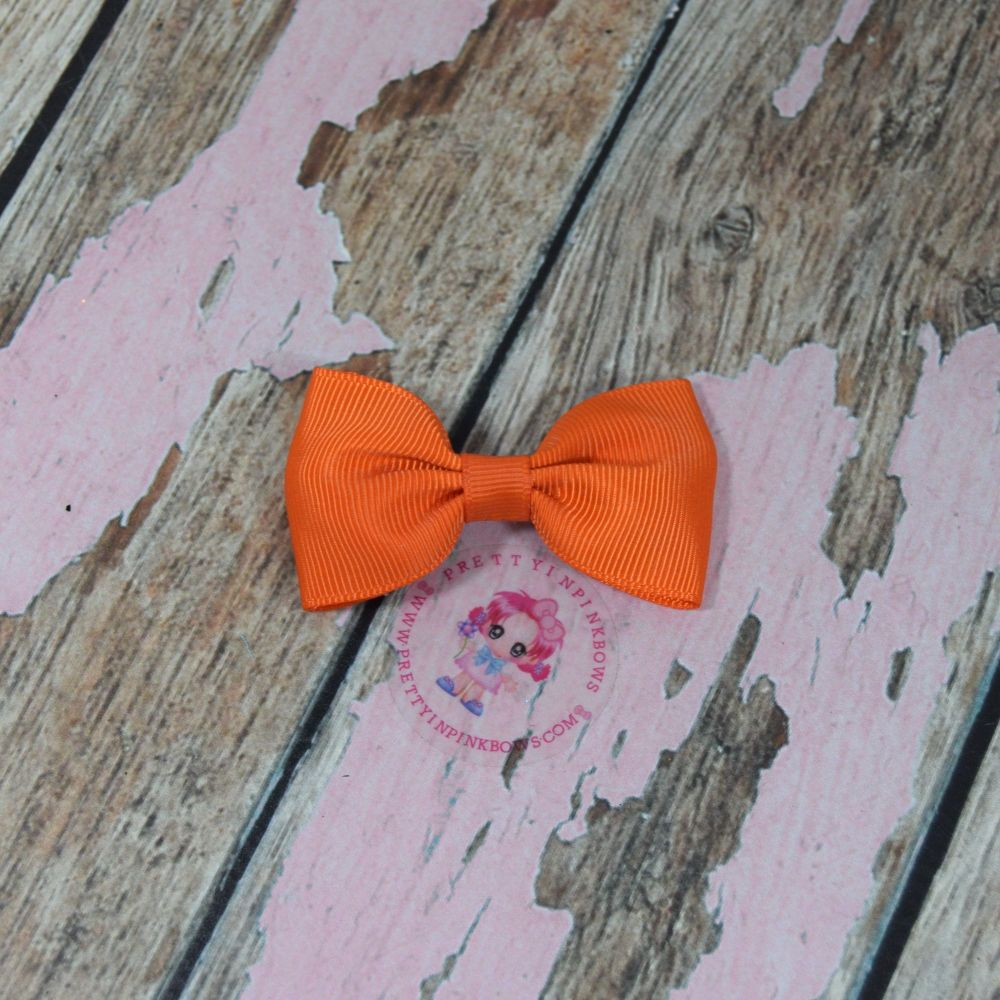 Minnie Bow on Croc Clip ~ Torrid Orange