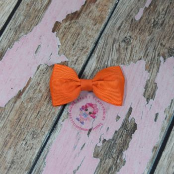 Minnie Bow on Croc Clip ~ Torrid Orange