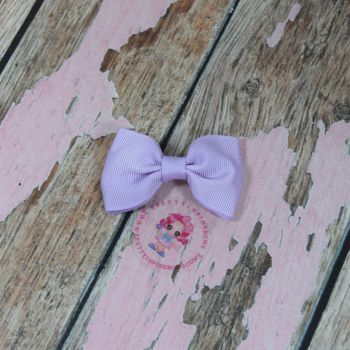 Minnie Bow On Croc Clip ~ Light Orchid