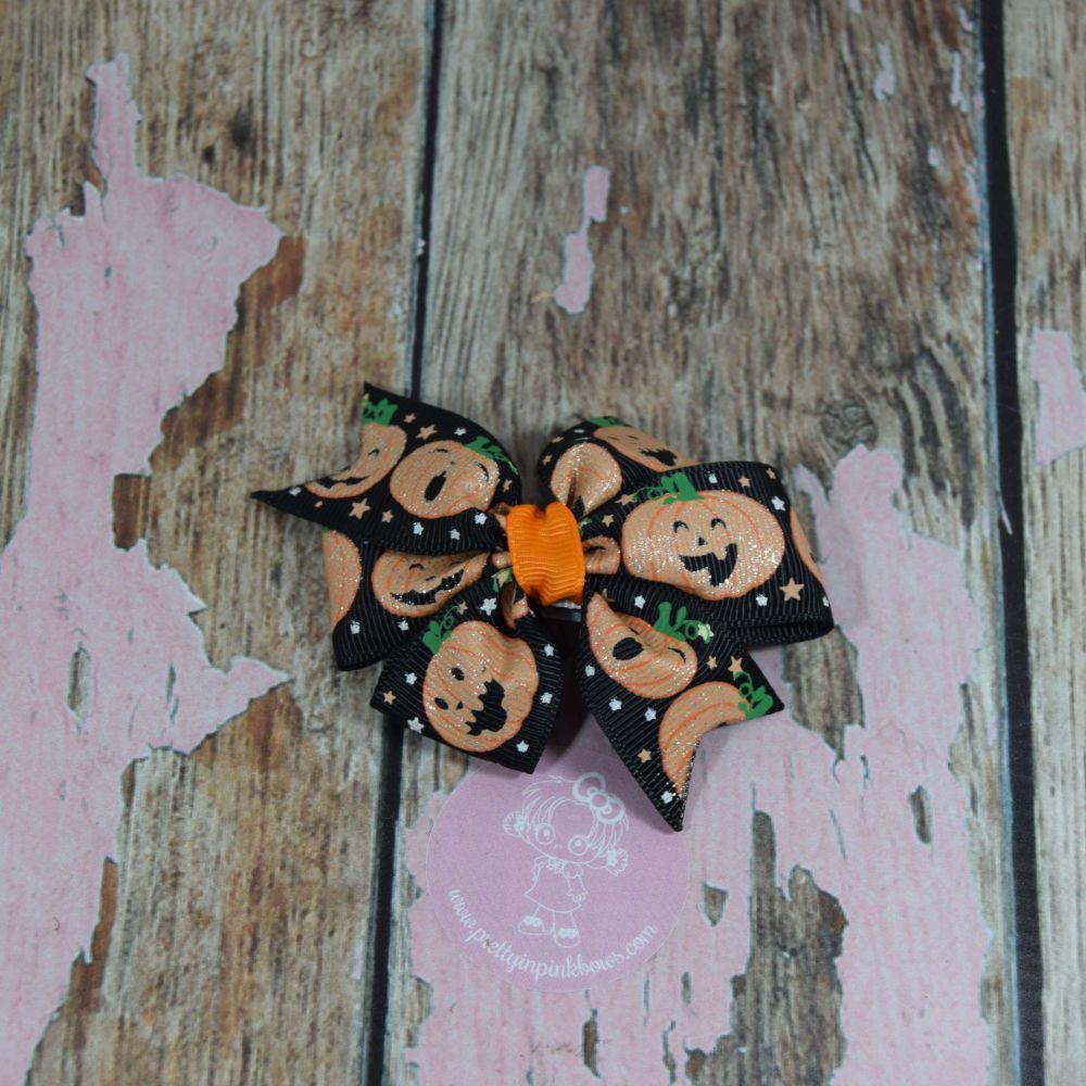 Pinwheel Bow Glitter Pumpkins on croc clips