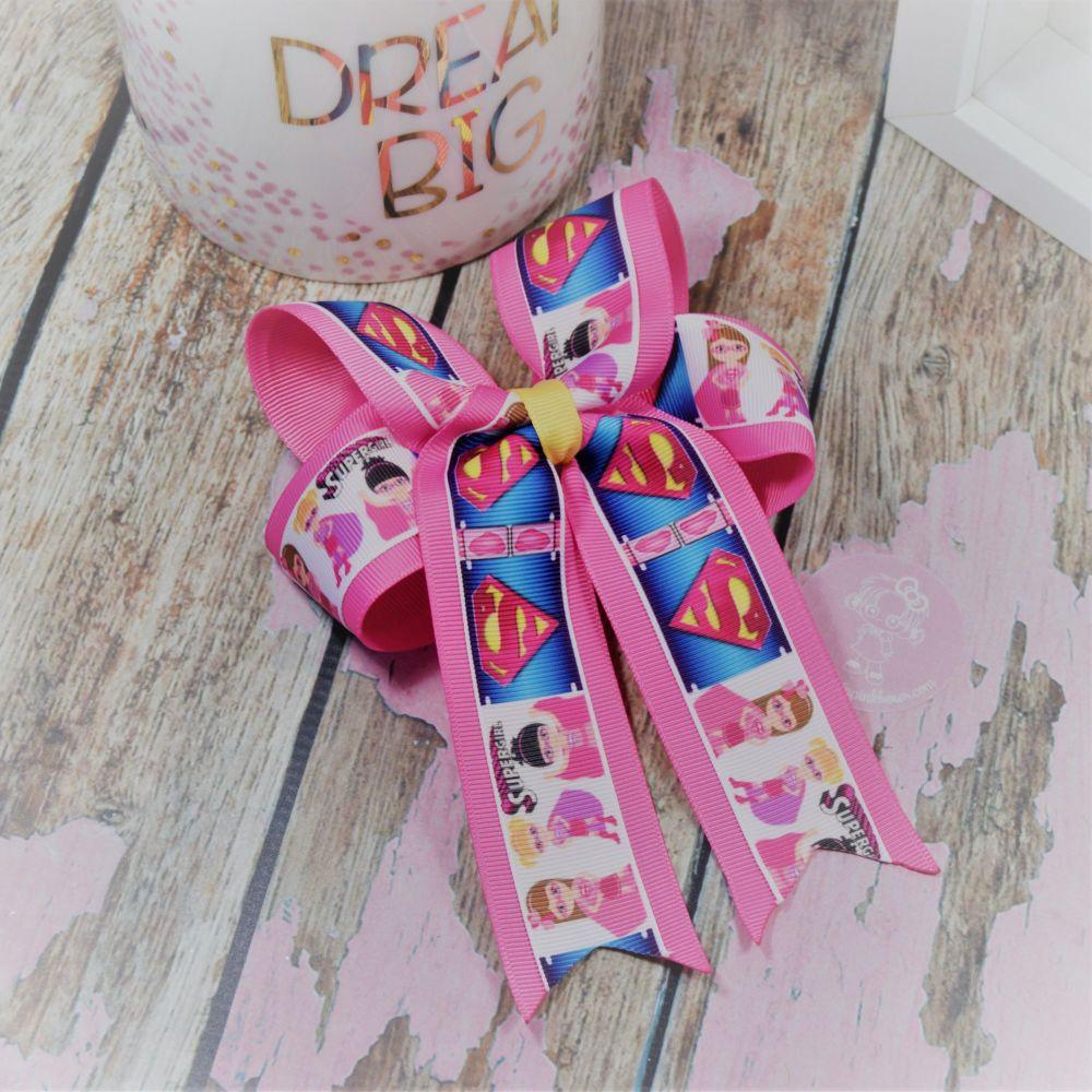Double Loop Tails (DLT) Pink Super Heros on Croc Clip