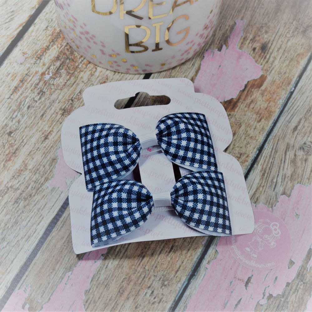 Minnie Bows in Navy gingham On Croc Clip