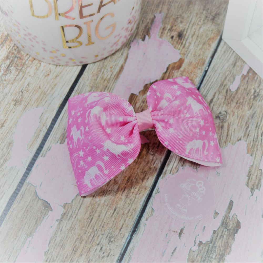 Large Minnie Bow Pink unicorns and stars On Croc Clip