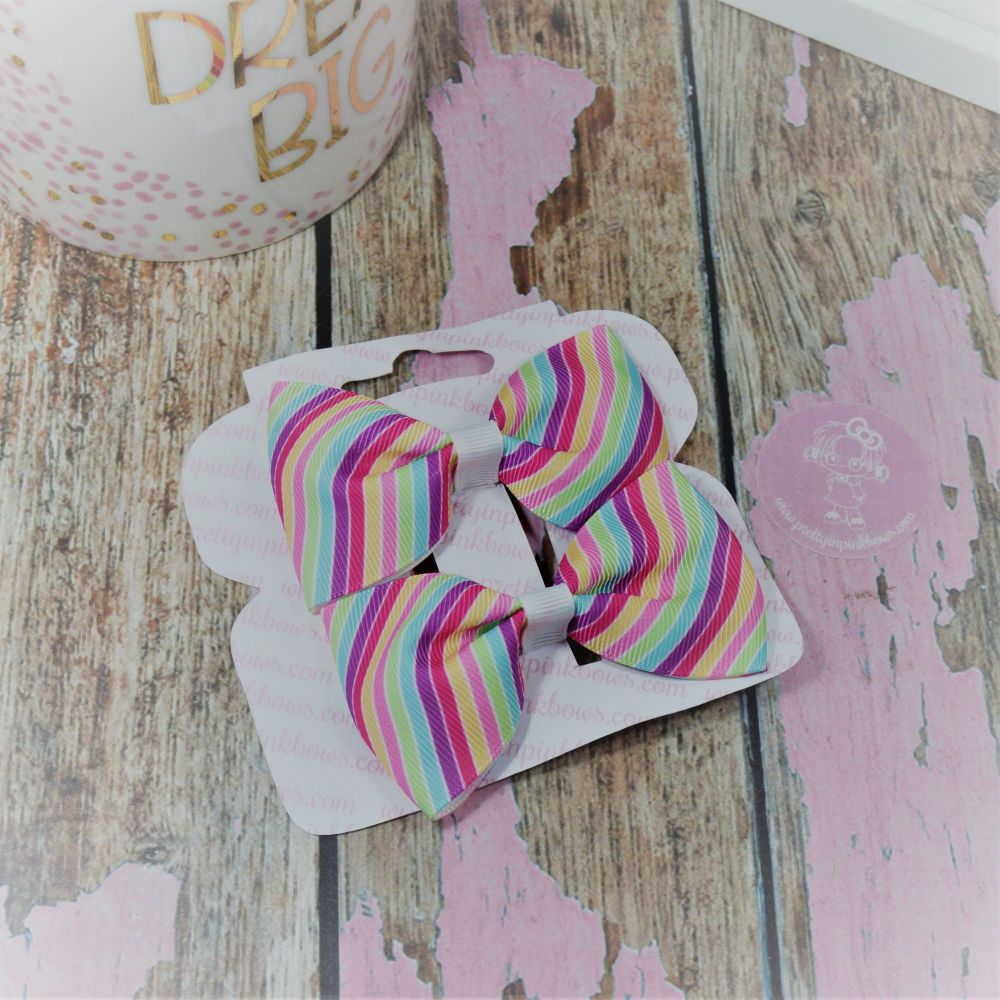 Minnie Bows Rainbow stripes On Croc Clip