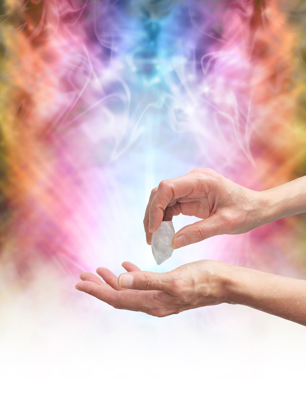 Hand holding a quartz point over the other hand