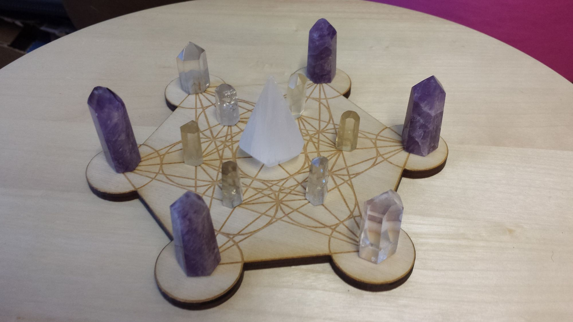 crystals on a flower of life grid