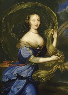 Athenais de Montespan with long curly hair, wearing a blue dress trimmed with golden gauze