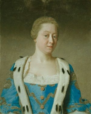 A portrait of Augusta of Saxe-Gotha, Dowager Princess of Wales, with her blonder hair scraped back from her face. She is wearing blue and gold robes trimmed with white fur and lace, but isn't wearing any jewellery.