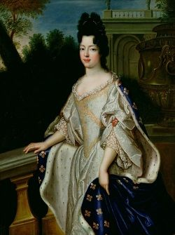 A portrait of Marie Adelaide of Savoy, her dark hair piled up on top of her head, wearing a white satin dress embroidered with gold and a blue cloak with gold fleur-de-lis.