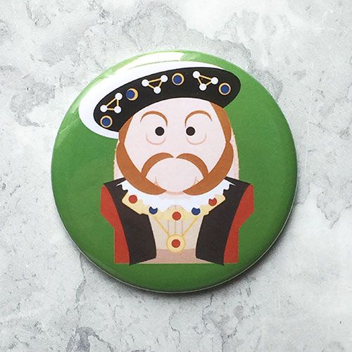 A round green fridge magnet with an image of King Henry VIII.