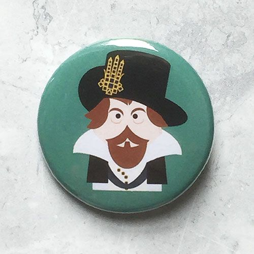 A round teal badge with a picture of King James I of England.