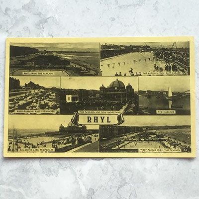 A vintage postcard showing scenes from Rhyl.