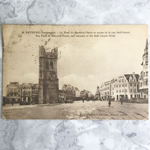An old photo of Bethune sqaure with a damaged belfry on the left.
