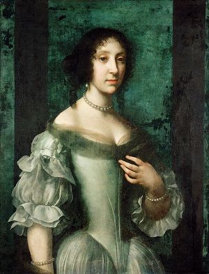 Claudia Felicitas of Austria, wearing a pale green dress and a necklace of pearls.