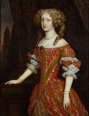Eleanore Magdalene of Neuberg, wearing a red and yellow dress, with her hair pinned up in curls on either side of her face.