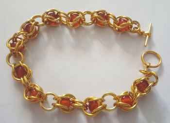 Gold Colour Chain Links and Red Agate Braclett with gold plated toggle clasp