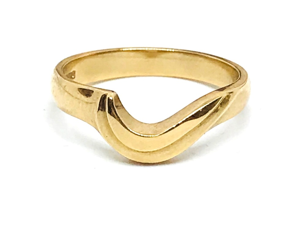 Gold Ring thats fits around another ring  in 9ct gold  3g