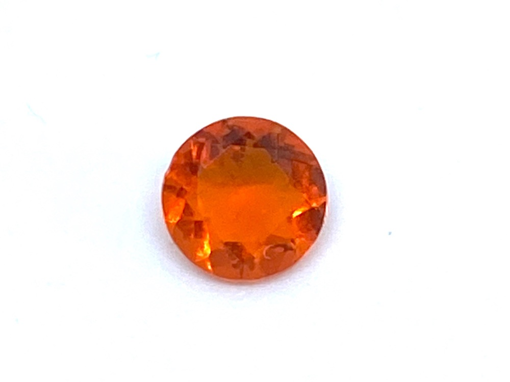 Fire Opal Round  0.32cts  5.2mm    Opa022