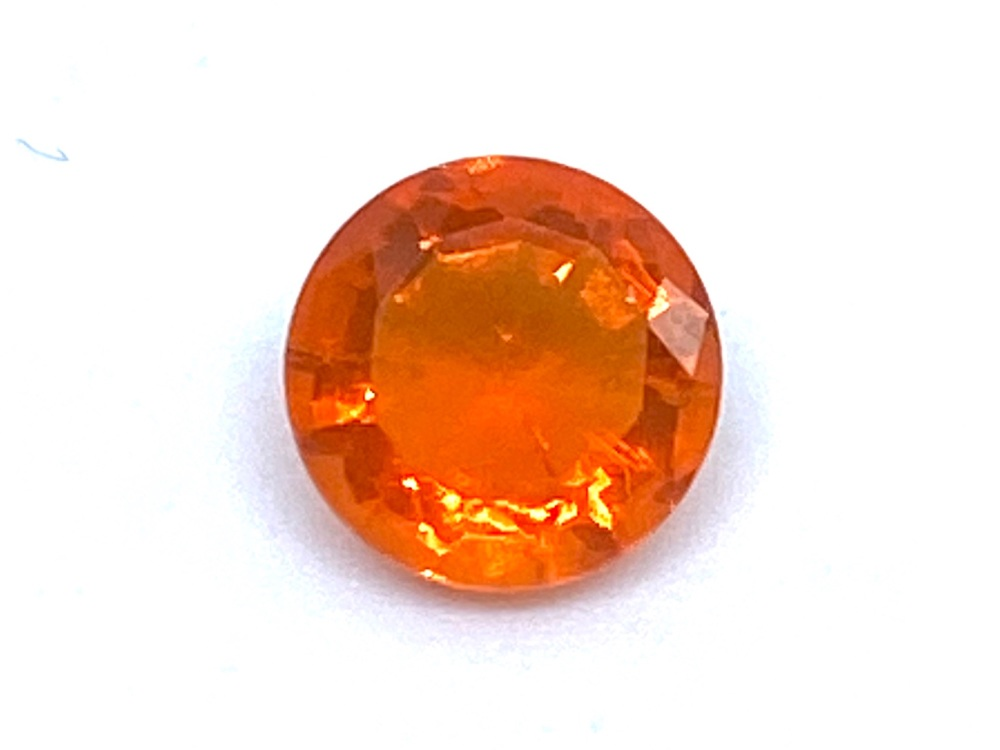 Fire Opal Round  0.33cts  5.3mm    Opa024
