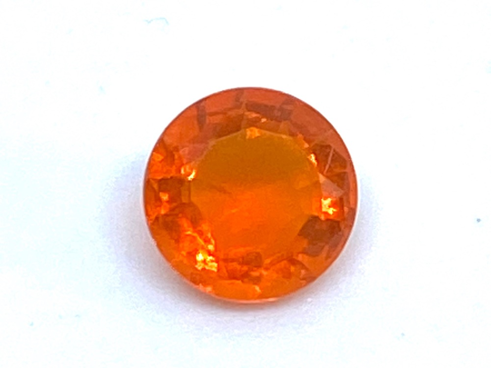 Fire Opal Round  0.36cts  5.4mm    Opa025