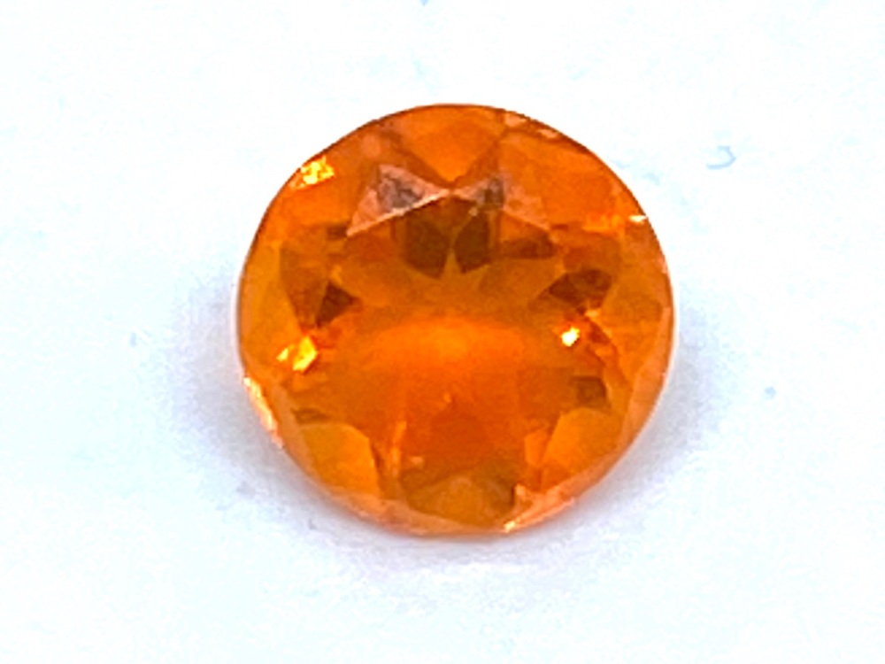 Fire Opal Round  0.37cts  5.3mm    Opa026