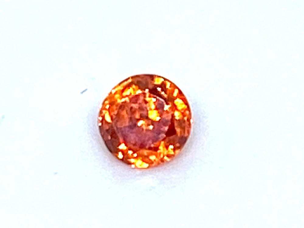 Fire Opal Round   0.73cts  4.5mm   Opa044