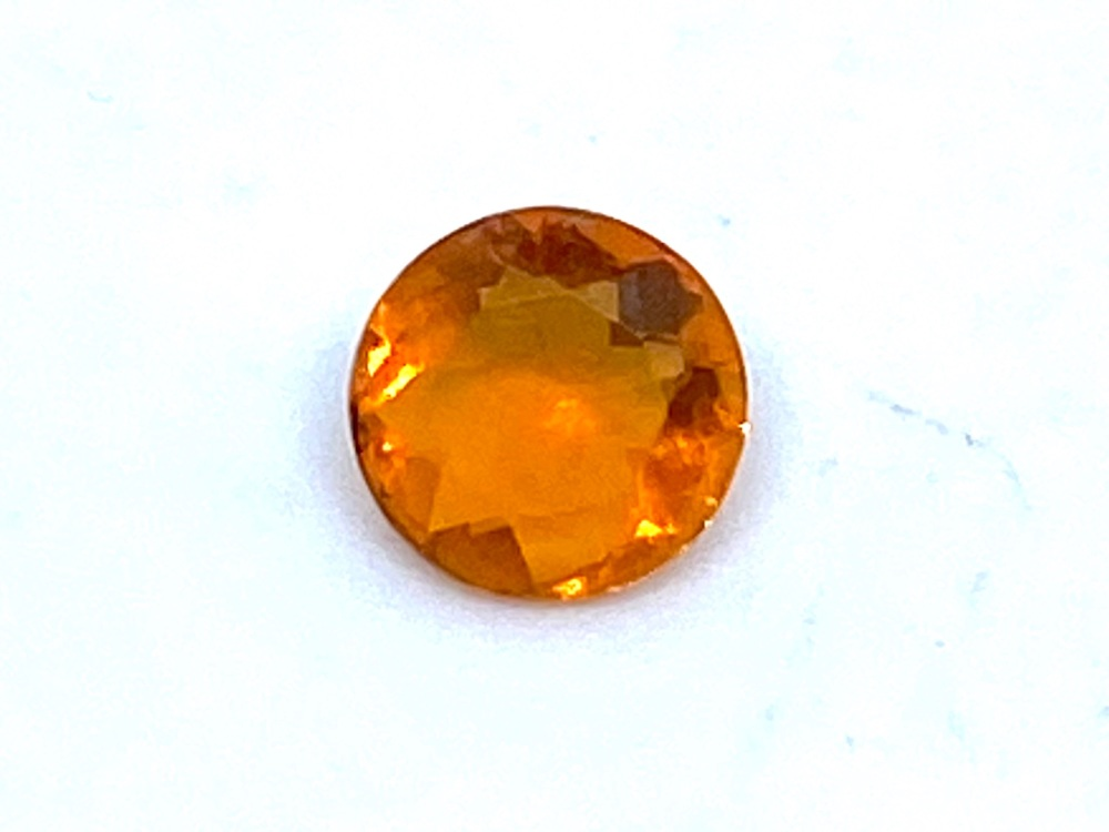Fire Opal Round  0.17cts  4.3mm    Opa051