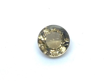 Tourmaline Yellow   6.7mm round  1.35cts Tou032