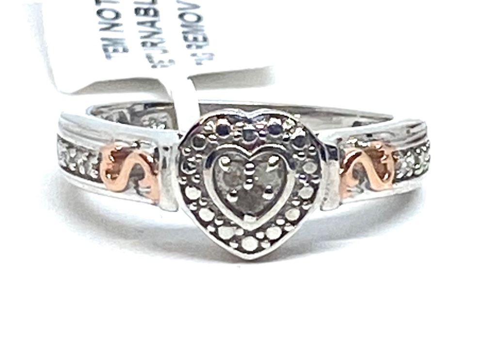 Diamond Ring Set in Silver with  Rose gold Overlay  0.10cts    Size P
