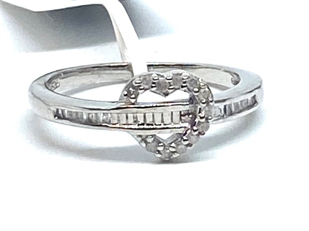 Diamond Ring Set in Silver   0.20cts    Size P