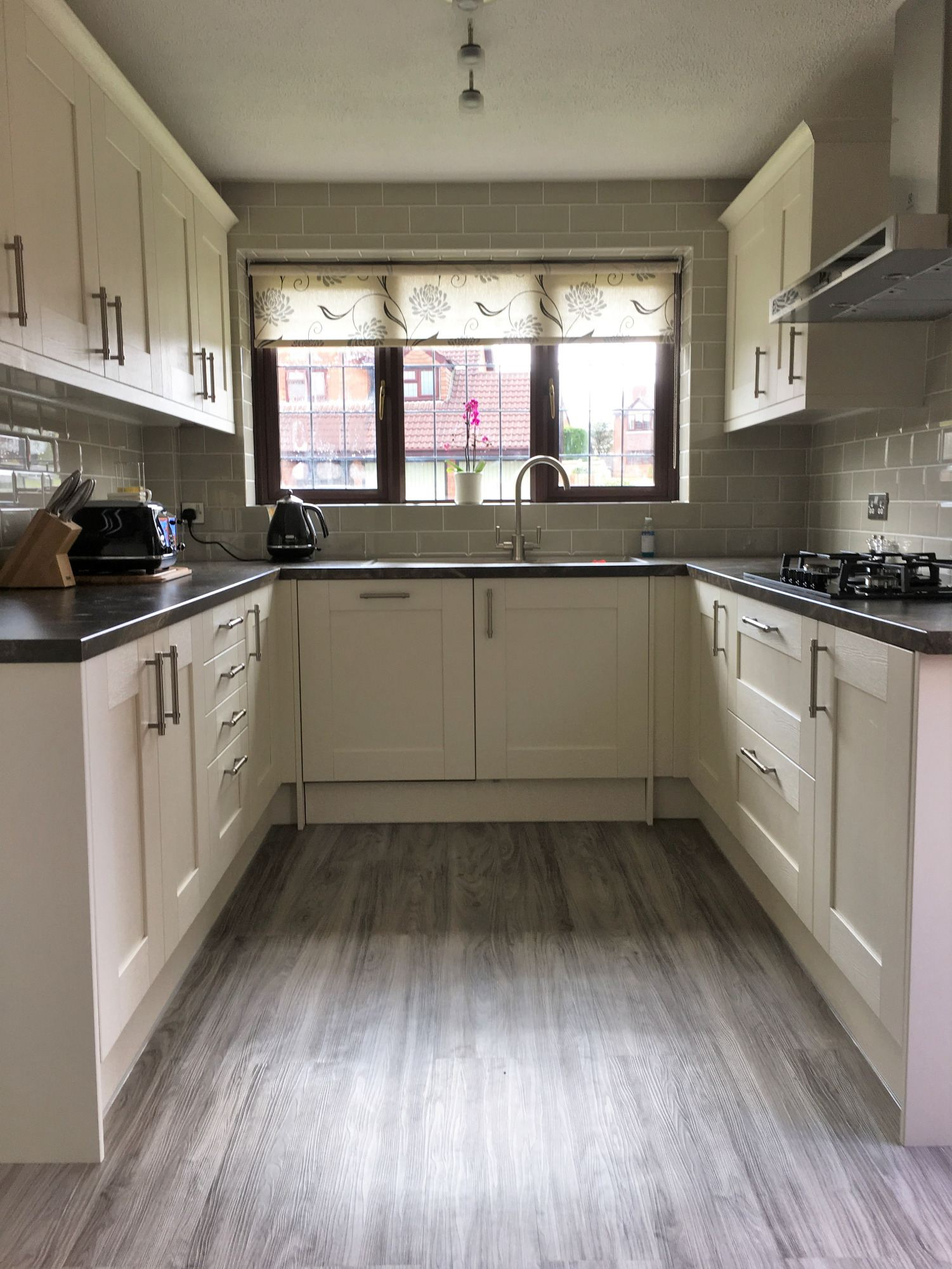 white magnet kitchen black silestone worktop grey flooring fitters derbyshire