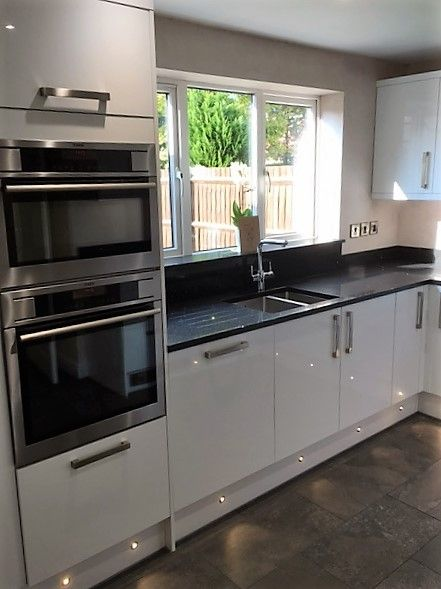 modern white gloss black granite worktop plinth lighting derbyshire