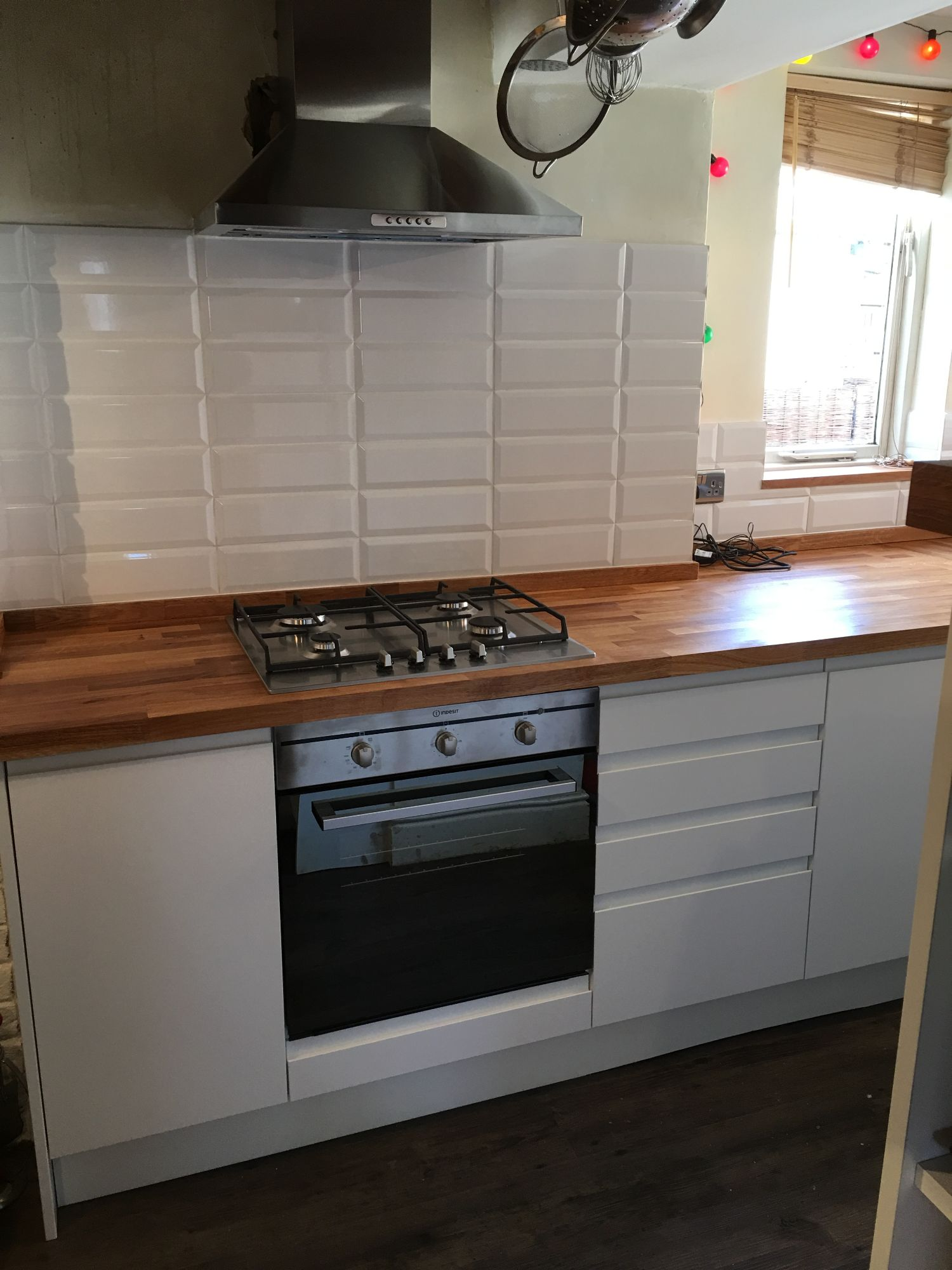 white metro brick pattern tiles wooden kitchen worktop white handleless kitchen doors derbyshire