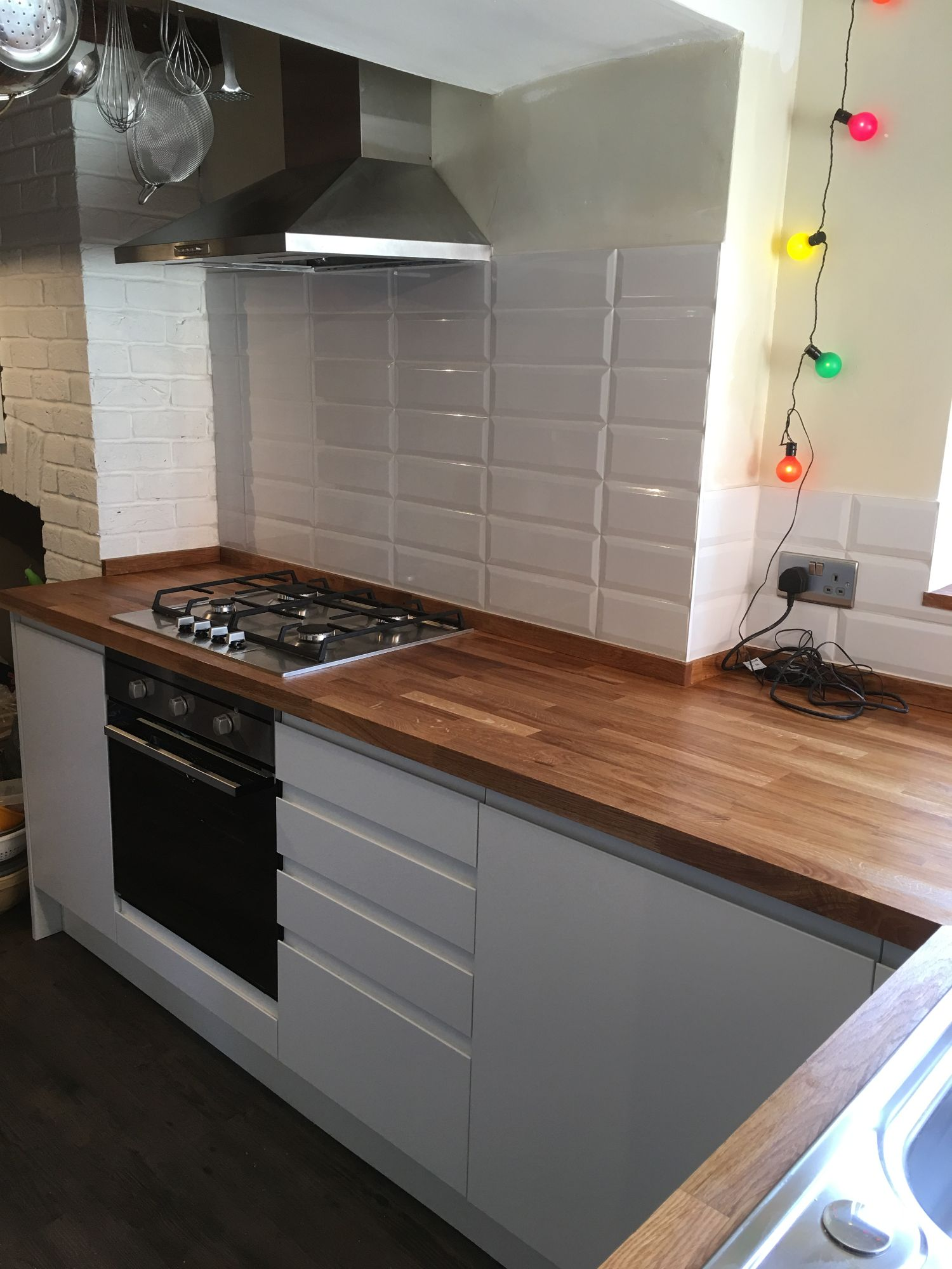 white metro tiles brick pattern wooden worktop white handleless doors staffordshire