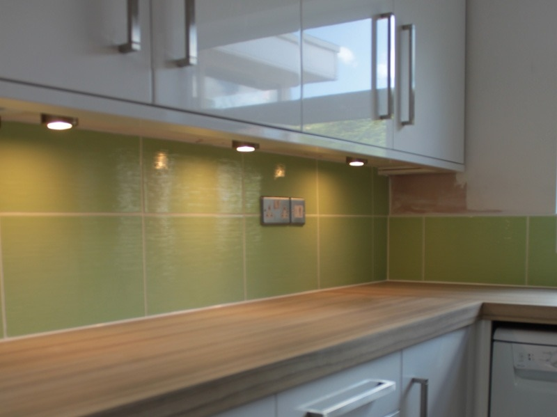 gloss white slab kitchen doors  green wall tiles derbyshire