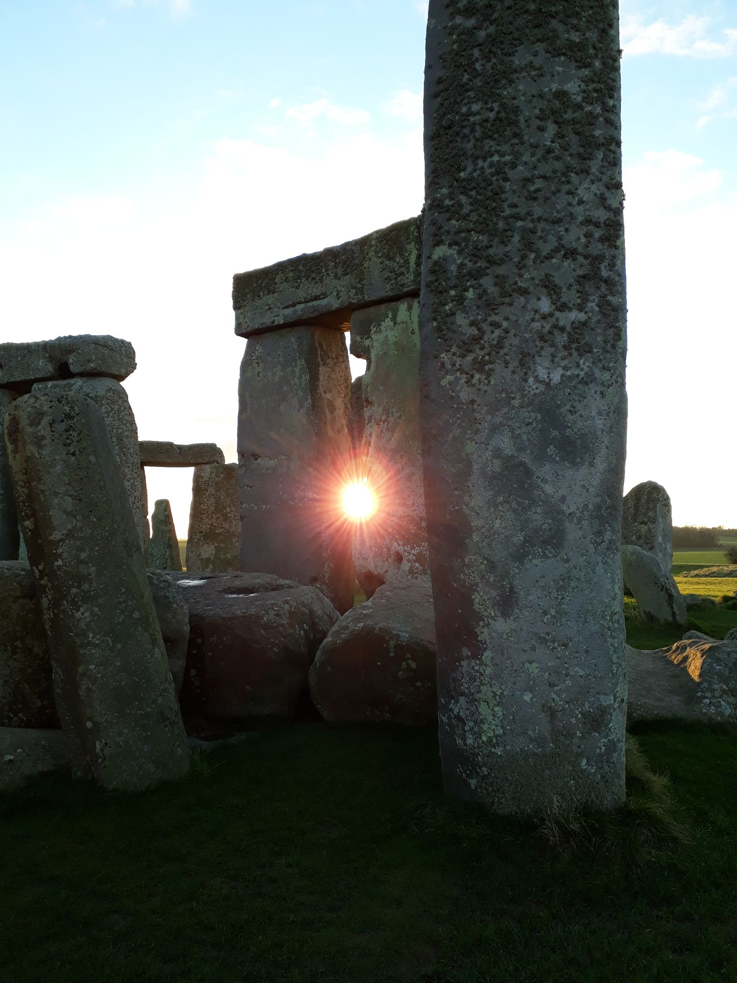 sunrise through the stones