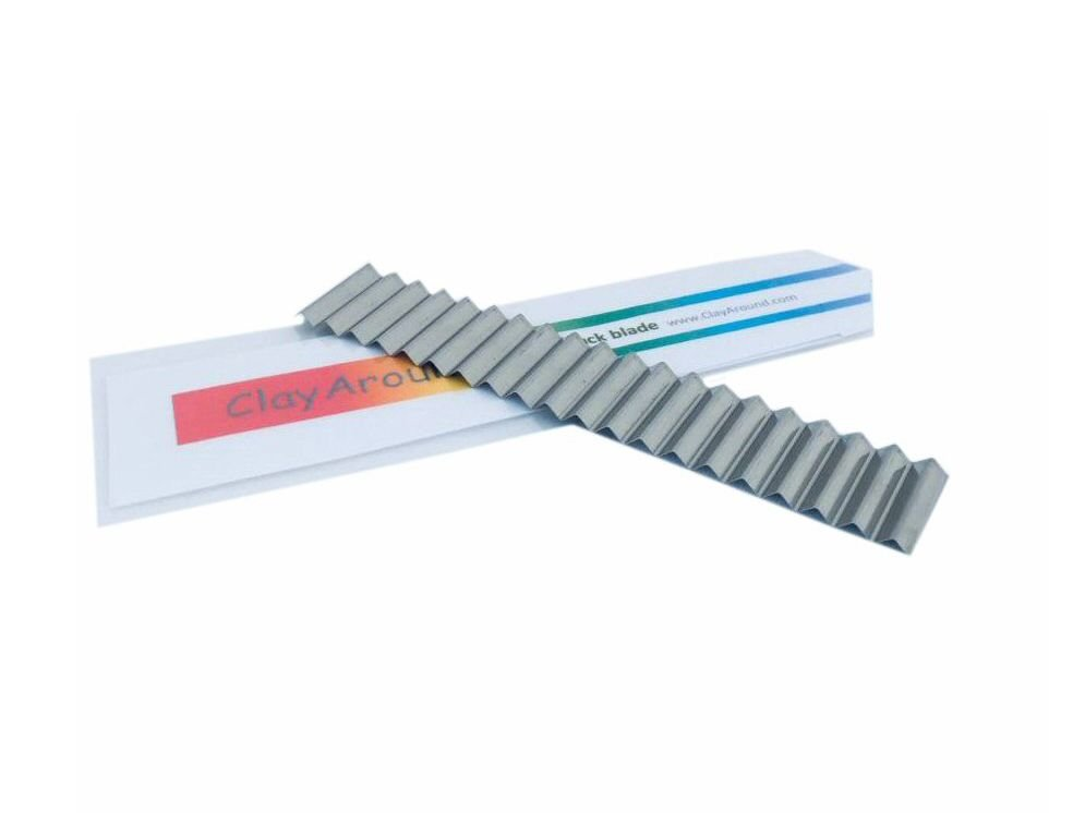 Wavy cut ripple blade