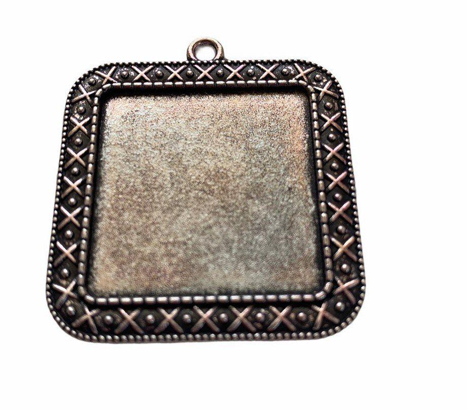 copper coloured square patterned bezel
