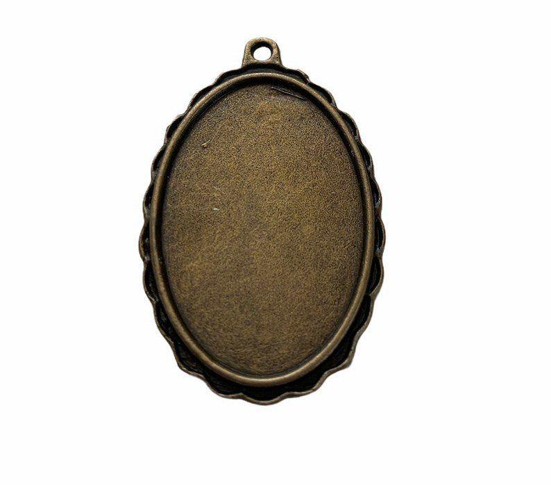bronze oval patterned bezel