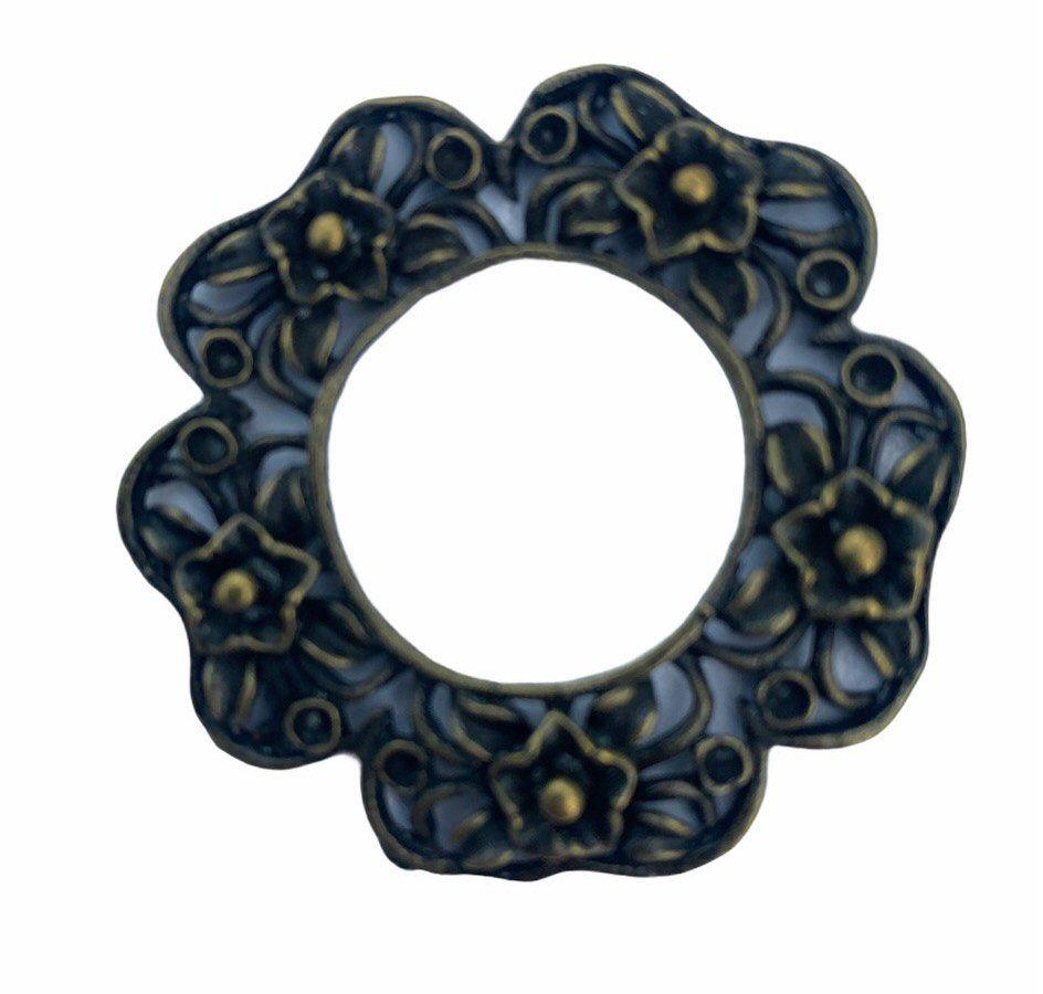 Bronze flower shaped frame