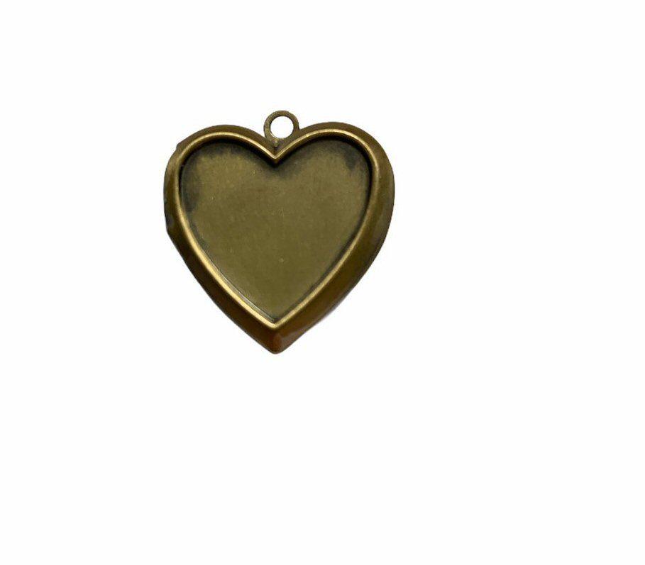Brtonze style heart locket tray