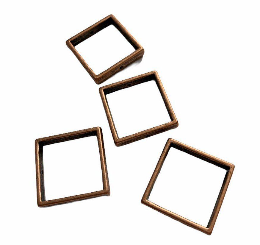 copper coloured square frames