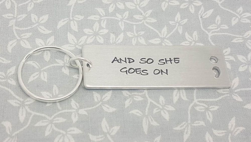 And so she goes on.. Semicolon Cut Out Keyring